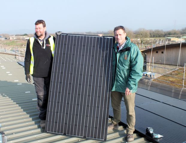 Alistair Mead with solar panel and electrician