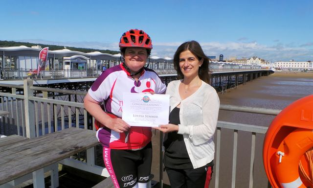 Louisa Summer being presented a certificate from Pier Director, Michelle Michael