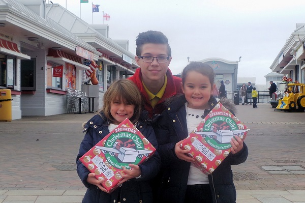 Emily FitzGerald & Sirenna Attwood present shoebox to Andrew Barnett at Grand Pier - Copy